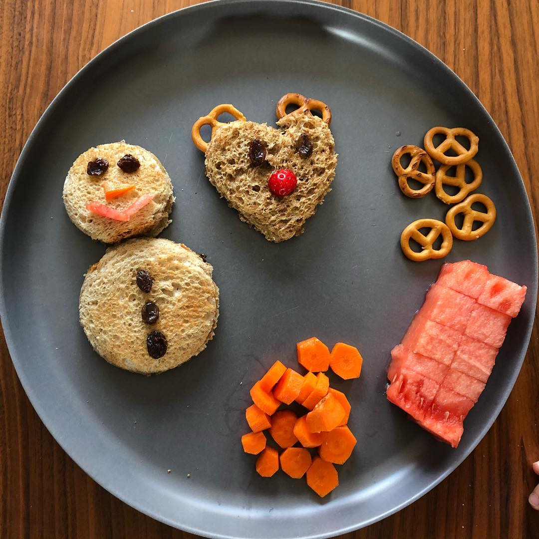 Everyone's a little sickly over here, so this is the best I could do for lunch: sun butter/honey Frosty/Rudolph sandwiches, gluten-free pretzels, watermelon, and carrots. My son was NOT about to eat a Frosty with no hat, so I ended up making one out of dried seaweed after this was taken. 💪🏼 Both of my kids eat peanut and almond butter, but we also enjoy sun butter from time to time. Try it