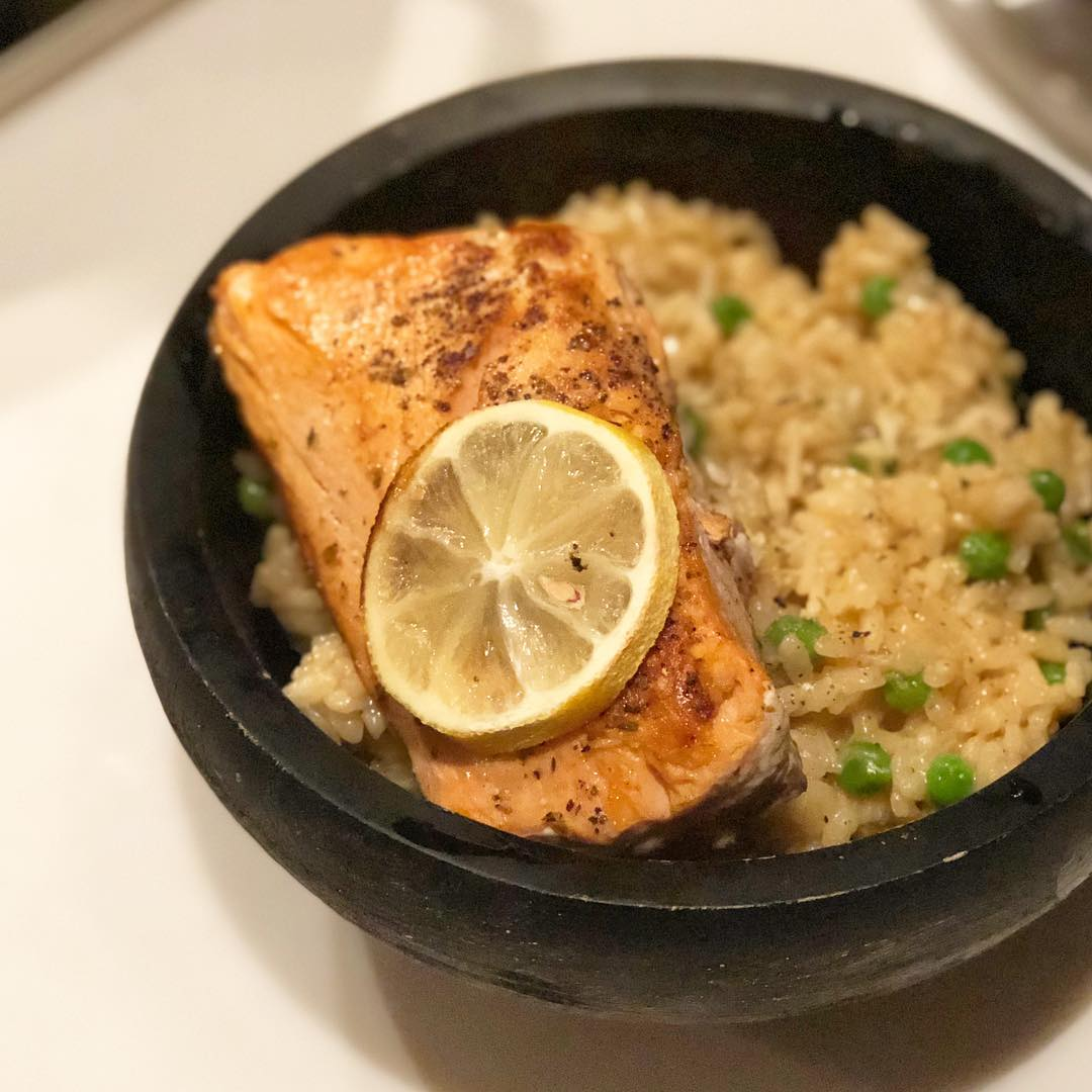 We had lemon pea risotto tonight with seared coho salmon. I cooked the risotto traditionally, low and slow, adding @remedybonebroth (ginger turmeric chicken) a ladle at a time. Just before the arborio was perfectly al dente, I added lemon zest, the juice of a lemon, frozen @traderjoes peas and grated Parmesan. The Copper River coho Salmon from @virgin_bay_seafood was lightly seasoned and seared on both sides in a cast iron skillet. Simple dinner, lots of flavor