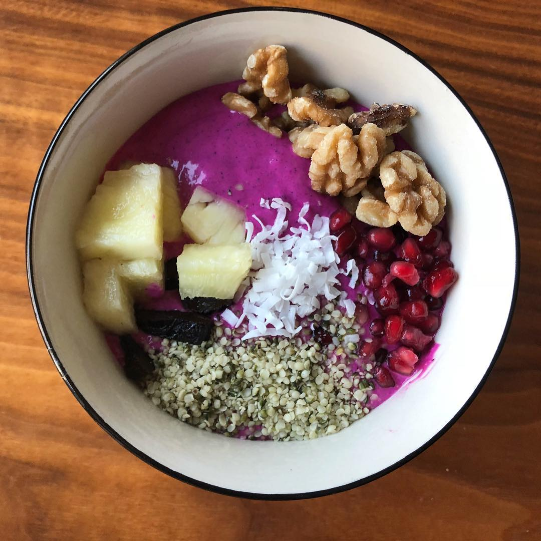 I'm still on my smoothie bowl kick even though I'm a little late to the dragonfruit party. I love the color and the flavor, maybe even more than acai. This one has frozen dragonfruit (pitaya), banana, kefir, peanut butter, and chia seeds blended until smooth. Toppings included pineapple, dried plums, hemp seeds, pomegranate seeds, walnuts and coconut. I've been adding a little water to the leftover base mixture (to thin it out) and giving it to my 14 month-old in a sippy cup. He looooves it