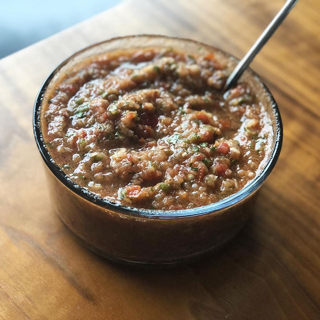 As a Texan, salsa-making is in my blood. I make several different varieties. This one is the easiest, where I use all raw ingredients. I quarter 4 heirloom tomatoes and 1 small yellow onion. Then I throw it all in the Vitamix and add 2 cloves garlic, 1 jalapeño, 1 Serrano, the juice of a lime, a big handful of cilantro, salt, pepper, cumin, paprika, and chili powder. Then, I just blend it until it's the consistency I prefer. Put it in the fridge to allow all the flavors to marry and you'll never buy jarred salsa again