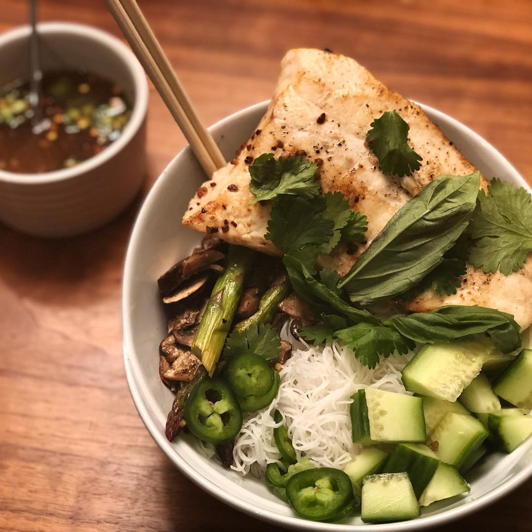 Halibut Vermicilli Bowls for dinner tonight. I seared the @virgin_bay_seafood Alaskan halibut in garlic and butter in a cast iron skillet, then broiled it for about 4 minutes and squeezed a little lime juice over the top. To make the sauce, I combined garlic, ginger, brown sugar, fish sauce, rice vinegar, lime juice, red pepper flakes and jalapeño. I served it with roasted portabella and asparagus, fresh cucumber and jalapeño, and garnished with basil and cilantro. I'm trying to minimize my carbs, so instead of vermicelli, I substituted power greens