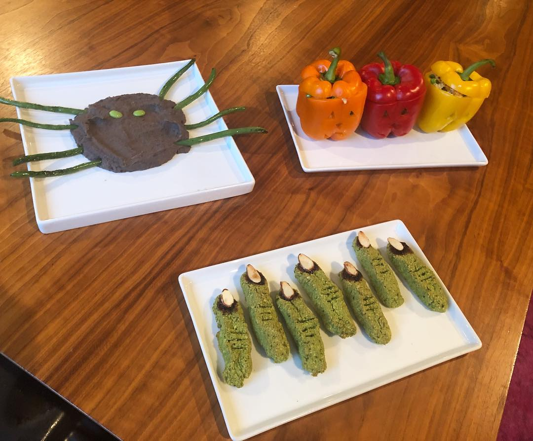 My sons have birthdays 7 days apart and Halloween is right in the middle of that week. Needless to say, we celebrate for a month. Tonight we had quinoa/English pea/sweet potato stuffed bell pepper jack o' lanterns, mashed black bean spider with green bean legs and edamame eyes, and green (kale) witch finger cookies with blackberry jam (blood) and slivered almond fingernails. My kids were too grossed out at the sight of the witch fingers to try them 😂, but everything else was a hit! This meal took about 30 minutes to prepare. Fast and fun